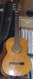 Aria Classical Guitar with gold soundhole rose